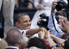 President Barack Obama shakes hands with supporters after speaking at a campaign event, Wednesday, Aug. 1, 2012, in Mansfield, Ohio. (AP Photo/Jay LaPrete)