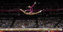 U.S. gymnast Gabrielle Douglas performs on the balance beam during the artistic gymnastics women's individual all-around competition at the 2012 Summer Olympics, Thursday, Aug. 2, 2012, in London. She won the gold medal. (AP Photo/Gregory Bull)