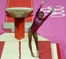 U.S. gymnast Gabrielle Douglas dismounts from the vault during the Artistic Gymnastic women's individual all-around competition at the 2012 Summer Olympics, Thursday, Aug. 2, 2012, in London. (AP Photo/Matt Dunham)