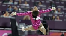 U.S. gymnast Gabrielle Douglas performs her final and deciding routine on the floor during the artistic gymnastics women's individual all-around competition at the 2012 Summer Olympics, Thursday, Aug. 2, 2012, in London. (AP Photo/Julie Jacobson)