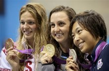 From left, Russia's Luliia Efimova, bronze, United States' Rebecca Soni, gold, and Japan's Satomi Suzuki, silver, pose on the podium after competing in the women's 200-meter breaststroke swimming final at the Aquatics Centre in the Olympic Park during the 2012 Summer Olympics in London, Thursday, Aug. 2, 2012. (AP Photo/Matt Slocum)