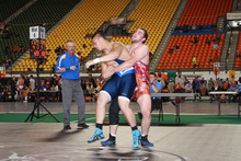 Roy Nash, in red, grapples with an opponent during the Western Regionals in Pocatello, Idaho. In mid-July, the 16-year-old earned double Cadet national championships in Greco-Roman and freestyle wrestling in the 220-pound weight class. Courtesy Terriann Nash