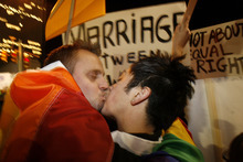 Chris Detrick | The Salt Lake Tribune Dan Bushman, left, kisses Sean Woodward during a protest outside of Temple Square over Prop. 8 in 2008.