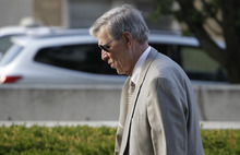 Judge Edward Burmila enters the Will County Courthouse, Thursday, Aug. 2, 2012, in Joliet, Ill., to preside over the third day in Drew Peterson's murder trial. Judge Burmila decided against declaring a mistrial in Peterson's murder case Thursday, saying the former police officer still can get a fair trial despite several blunders by prosecutors, who are seeking to prove the 58-year-old Peterson killed his third wife, Kathleen Savio, in 2004. (AP Photo/M. Spencer Green)