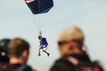 A skydiver prepares to land, Thursday, Aug. 2, 2012, in Ottawa, Ill. More than 140 skydivers reaching speeds in excess of 180 mph gathered in the skies over central Illinois to set a new world record in vertical flying. (AP Photo/Sitthixay Ditthavong)