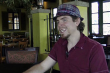 In this image taken from video shot July 18, 2012, Seth Collins talks about leaving a $500 tip for 21-year-old waitress Chelsea Powell at Bella Notte restaurant in Lexington, Ky. Seth's brother, Aaron Collins, who died on July 7, left instructions in his will to leave a $500 tip for a server. Since Collins' July 7 video of him telling his brother's story and handing Powell the cash went viral, donors inspired by Aaron's dying act of charity have contributed $47,000. (AP Photo)