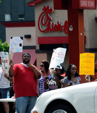 Gay rights groups and others protest outside the Decatur, Ga., Chick-fil-A restaurant Friday, Aug. 3, 2012. Gay rights activists plan kiss demonstrations at Chick-fil-A stores Friday, just days after the company set a sales record when customers flocked to the restaurants to show support for the fast-food chain owner's opposition to gay marriage. (AP Photo/David Tulis)