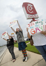 Gay marriage supporters, from left, Emmie Hesley, Cathy Dear and Amy Paffenroth hold signs in front of a Chick-fil-A in Fort Walton Beach, Fla. Thursday Aug. 2, 2012, in protest of the chicken eatery's stance on gay marriage. (AP Photo/Northwest Florida Daily News, Nick Tomecek)