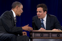 President Barack Obama laughs with Jimmy Fallon during commercial break as he participates in a taping of the Jimmy Fallon Show, Tuesday, April 24, 2012, at the University of North Carolina at Chapel Hill, N.C..  (AP Photo/Carolyn Kaster)