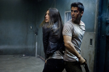 This film image released by Columbia Pictures shows Jessica Biel , left, and Colin Farrell in a scene from the action thriller