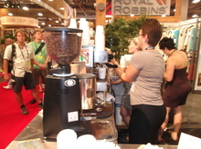 In the morning and early afternoon, coffee (like that being served here at the Royal Robbins booth) fuels the Outdoor Retailer Summer Market. At 4 p.m., though, another magical beverage makes its presence known. It's called beer. (Photo by Sean P. Means  |  The Salt Lake Tribune)