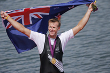 New Zealand' Mahe Drysdale celebrates after winning the gold medal for the men's rowing single sculls in Eton Dorney, near Windsor, England, at the 2012 Summer Olympics, Friday, Aug. 3, 2012. (AP Photo/Emilio Morenatti)