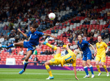 France's Laura Georges, left, battles for the ball with Sweden's Caroline Seger (15) during their quarter-final women's soccer match at the London 2012 Summer Olympics, Friday, Aug. 3, 2012, at Hampden Park Stadium in Glasgow, Scotland. (AP Photo/Chris Clark)