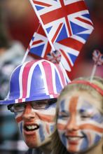 Fans of Great Britain watch the competition at the rowing venue in Eton Dorney, near Windsor, England, at the 2012 Summer Olympics, Friday, Aug. 3, 2012. (AP Photo/Natacha Pisarenko)