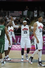 USA Carmelo Anthony (15) gets high fives from Chris Paul (13) as he walks off the court during a timeout  against Nigeria Thursday, August 2, 2012 at the London 2012 Summer Games.   John Leyba, The Denver Post