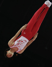 Japan's Masaki Ito performs during the men's trampoline qualification at the 2012 Summer Olympics, Friday, Aug. 3, 2012, in London.  (AP Photo/Gregory Bull)