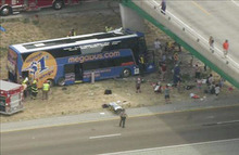 In this photo from video provided by KSDK-TV NewsCenter5 in St. Louis, first responders work the scene of a charter bus crash on Interstate 55 near Litchfield, Ill. Thursday, Aug. 2, 2012. The double-decker Megabus carrying 81 passengers blew a tire and slammed head-on into a concrete bridge support pillar. Four people injured in the crash were flown by helicopter to a trauma center, others were treated at local hospitals. (AP Photo/Courtesy KSDK-TV NewsCenter5 in St. Louis)