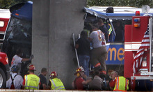First responders work the scene of a charter bus crash on Interstate 55 near Litchfield, Ill. Thursday, Aug. 2, 2012. The double-decker Megabus carrying 81 passengers blew a tire and slammed head-on into a concrete bridge support pillar. Four people injured in the crash were flown by helicopter to a trauma center, others were treated at local hospitals. (AP Photo/The State Journal-Register, David Spencer)