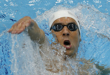 United States' Michael Phelps swims in his men's 200-meter individual medley heat at the Aquatics Centre in the Olympic Park during the 2012 Summer Olympics in London, Wednesday, Aug. 1, 2012. (AP Photo/Daniel Ochoa De Olza)