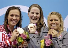 From left, Russia's Anastasia Zueva, silver, United States' Missy Franklin, gold, United States' Elizabeth Beisel, bronze, pose with their medals on the podium after theue win in the women's 200-meter backstroke at the Aquatics Centre in the Olympic Park during the 2012 Summer Olympics in London, Friday, Aug. 3, 2012. (AP Photo/Michael Sohn)