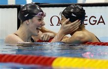 United States' Missy Franklin, left, and compatriot Elizabeth Beisel celebrate after their first and third place finishes in the women's 200-meter backstroke final at the Aquatics Centre in the Olympic Park during the 2012 Summer Olympics in London, Friday, Aug. 3, 2012. (AP Photo/Michael Sohn)