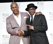 Former heavyweight boxer Mike Tyson, left, and director Spiken Lee announce