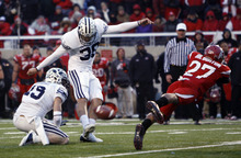 Trent Nelson  |  The Salt Lake Tribune  Utah Utes cornerback Brandon Burton #27 blocks field goal attempt by BYU kicker Mitch Payne (38) at Rice-Eccles Stadium Saturday, November 27, 2010. The final score was Utah 17-BYU 16.
