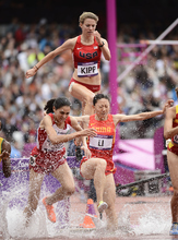 USA Shalaya Kipp hits the water jump in the women's 3000m steeplechase during track & field Saturday, August 4, 2012 at the London 2012 Summer Games. John Leyba, The Denver Post