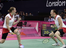 Denmark's Christinna Pedersen, left, and Kamilla Rytter Juhl celebrate after winning the first game of the women's doubles badminton match against Tian Qing and Zhao Yunlei of China, at the 2012 Summer Olympics, Tuesday, July 31, 2012, in London. (AP Photo/Andres Leighton)