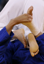 Feet get tangled during a match between Yoshie Ueno of Japan and Marijana Miskovic of Croatia in the women's 63-kg judo competition at the 2012 Summer Olympics, Tuesday, July 31, 2012, in London. (AP Photo/Paul Sancya)