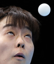 Kasumi Ishikawa of Japan competes against Yuegu Wang of Singapore during the women's singles table tennis competition at the 2012 Summer Olympics, Tuesday, July 31, 2012, in London. (AP Photo/Sergei Grits)
