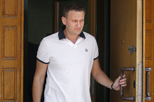Russian protest leader Alexei Navalny leaves the offices of the Russian Investigation committee in Moscow, Russia, Tuesday, July 31, 2012. Russia's top investigative agency says it has opened a new criminal probe against opposition leader Alexei Navalny on allegations of theft. The 36-year-old corruption-fighting lawyer and popular blogger has played a key role in rallying Russia's young Internet generation against Vladimir Putin's rule. (AP Photo/Misha Japaridze)