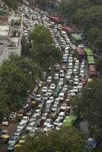 A road is packed in heavy traffics following power outage and rains in the central part of New Delhi, India, Tuesday, July 31, 2012. India's energy crisis spreadover half the country Tuesday when both its eastern and northern electricity gridscollapsed, leaving 600 million people without power in one of the world's biggest-ever blackouts. Traffic lights went out across New Delhi. (AP Photo/Rajesh Kumar Singh)