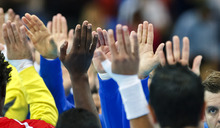 The teams of Tunisia, left, and Iceland, right, clasp hands before their men's handball preliminary match at the 2012 Summer Olympics, Tuesday, July 31, 2012, in London. (AP Photo/Vadim Ghirda)