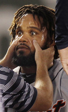 Detroit Tigers' Prince Fielder is examined by a trainer after being hit in the head by the ball while sliding safely back into second base on a pick-off attempt during the fourth inning of a baseball game against the Boston Red Sox at Fenway Park in Boston, Wednesday, Aug. 1, 2012. Fielder stayed in the game. (AP Photo/Winslow Townson)