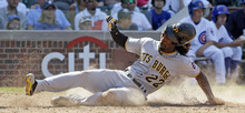 Pittsburgh Pirates' Andrew McCutchen scores on a single hit by Garrett Jones during the eighth inning of a baseball game against the Chicago Cubs in Chicago, Wednesday, Aug. 1, 2012. (AP Photo/Nam Y. Huh)