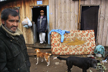 In this June 14, 2012 photo, Rodrigo Contreras, left, and his neighbor Juan Carlos Mena, who are both unemployed, stand in El Penon, a camp created by people who do not own land but who build their homes there, in the Puente Alto sector of Santiago, Chile. The distribution of income in Chile is the most unequal among developed nations, according to the Organization for Economic Cooperation and Development (OECD).  (AP Photo/Victor Ruiz Caballero)