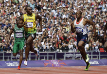 Jamaica's Usain Bolt, center, leads ahead of Nigeria's Ogho-Oghene Egwero, left, and Britain's James Dasaolu in a men's 100-meter heat during the athletics in the Olympic Stadium at the 2012 Summer Olympics, London, Saturday, Aug. 4, 2012. (AP Photo/Lee Jin-man)