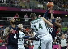 USA's Kobe Bryant puts up a shot against Lithuania's Jonas Valanciunas (14) during a men's basketball game at the 2012 Summer Olympics, Saturday, Aug. 4, 2012, in London.  At left is USA's Tyson Chandler. (AP Photo/Charles Krupa)
