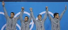 United States' men's 4 X 100-meter medley relay team from left, Matthew Grevers, Brendan Hansen, Michael Phelps and Nathan Adrian react at the Aquatics Centre in the Olympic Park during the 2012 Summer Olympics in London, Saturday, Aug. 4, 2012. (AP Photo/Jae C. Hong)