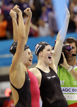 United States'  women's 4 x 100-meter medley relay team Dana Vollmer, right, Rebecca Soni, center, and Missy Franklin, left, celebrate as their teammate finishes, winning the yeam a gold medal, at the Aquatics Centre in the Olympic Park during the 2012 Summer Olympics in London, Saturday, Aug. 4, 2012. (AP Photo/Lee Jin-man)