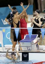 United States' women's 4 x 100-meter medley relay team members from left, Dana Vollmer, Rebecca Soni, Missy Franklin and Alison Schmitt, bottom, celebrate after winning the gold medal at the Aquatics Centre in the Olympic Park during the 2012 Summer Olympics in London, Saturday, Aug. 4, 2012. (AP Photo/Michael Sohn)