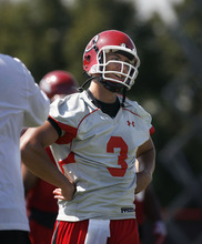 Scott Sommerdorf  |  The Salt Lake Tribune              Utah QB Jordan Wynn turns to look at Offensive Coordinator Brian Johnson after hitting a deep receiver during the opening day of Utah football training camp, Thursday, August 2, 2012.
