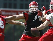 Scott Sommerdorf  |  The Salt Lake Tribune              Utah DL Junior Salt II rushes the QB during the opening day of Utah football training camp, Thursday, August 2, 2012.