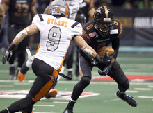 PNI0805-spt rattlers  073012419tk   --  8/4/12- Arizona Rattlers WR Markee White, (CQ) tries to get by Utah Blaze defender David Hyland (CQ) during Saturday's playoff game at U.S. Airways Center. Pat Shannahan/The Arizona Republic