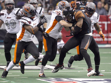 PNI0805-spt rattlers  073012419tk   --  8/4/12- Arizona Rattlers WR Kerry Reed (CQ) is tackled by Utah Blaze defenders during Saturday's playoff game at U.S. Airways Center. Pat Shannahan/The Arizona Republic