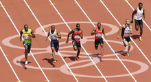 From left, Jamaica's Usain Bolt, Britain's James Dasaolu, Antigua and Barbuda's Daniel Bailey, Saint Kitts and Nevis' Jason Rogers, Egypt's Amr Ibrahim Mostafa Seoud, and Guinea-Bissau Holder da Silva compete in a men's 100-meter heat during the athletics in the Olympic Stadium at the 2012 Summer Olympics, London, Saturday, Aug. 4, 2012. (AP Photo/Michael Sohn)
