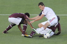Real Salt Lake forward Justin Braun (13) is tripped by Colorado Rapids defender Marvell Wynne, left, and Joseph Nane (21) during the first half of an MLS soccer game in Commerce City, Colo., Saturday, Aug., 4, 2012. (AP Photo/Jack Dempsey)
