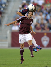 Colorado Rapids midfielder Brian Mullan (11) heads the ball against Real Salt Lake defender Chris Wingert (17) during the first half of an MLS soccer game in Commerce City, Colo., Saturday, Aug., 4, 2012. (AP Photo/Jack Dempsey)