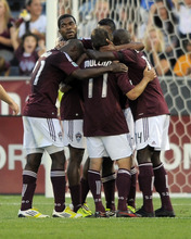Colorado Rapids Joseph Nane, top left, looks from a team huddle after scoring a goal against Real Salt Lake during the first half of an MLS soccer game in Commerce City, Colo., Saturday, Aug., 4, 2012. (AP Photo/Jack Dempsey)